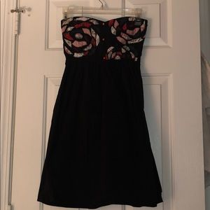 Black strapless dress with patchwork details